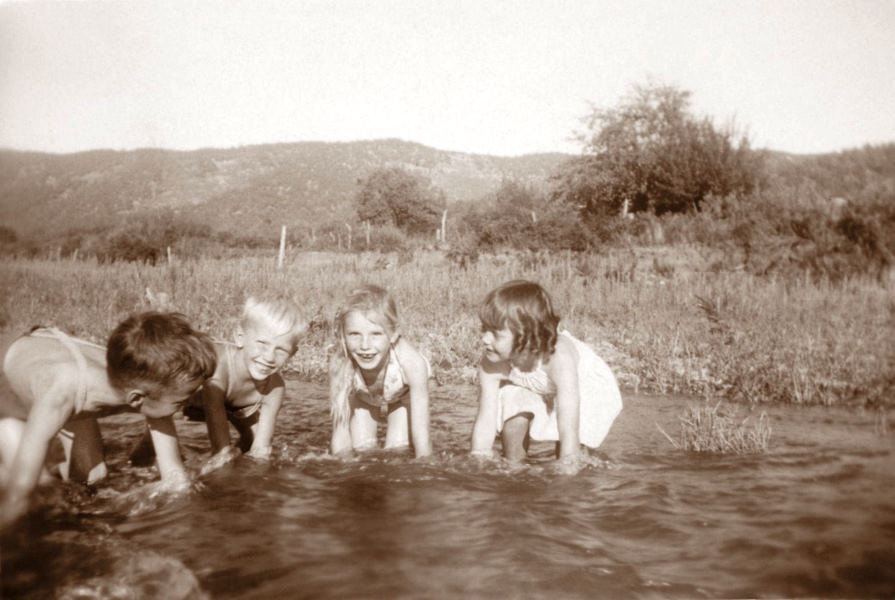 1945-08-25 A.J., Georgia Ruth, and their cousins play in the Ruidoso River on the Harland farm near Biscuit Hill