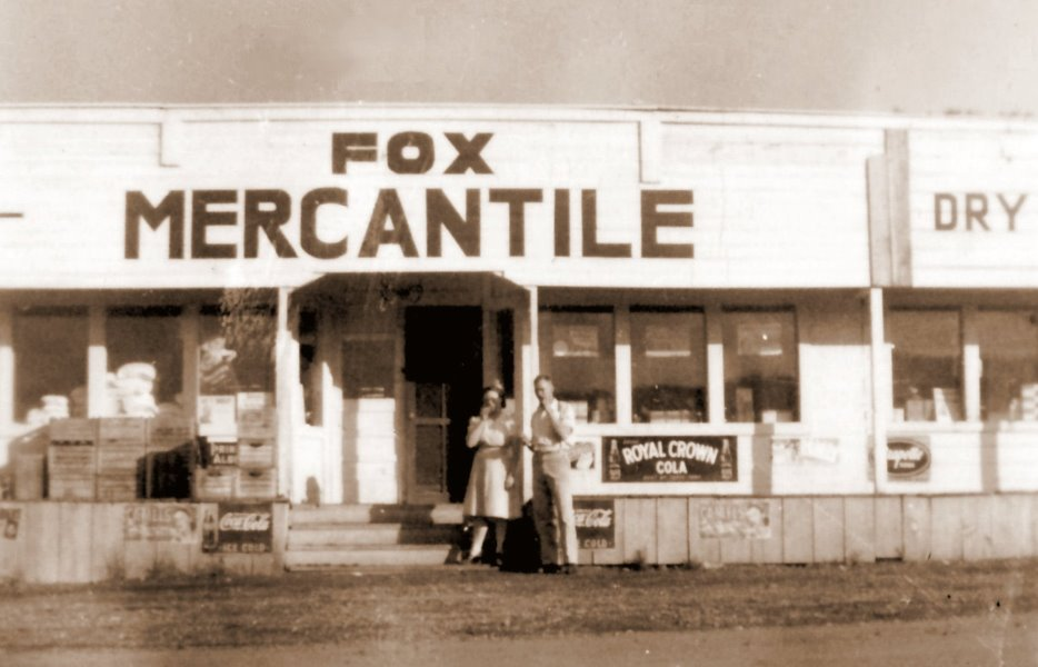 1948-06 Mildred and George in front of Fox Mercantile in Greentree