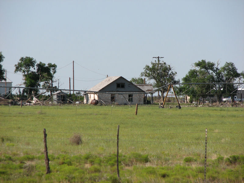 A telephoto view of the ranch, seen from the road