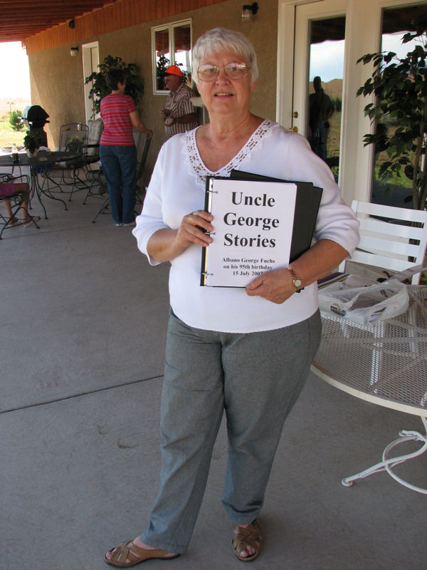 Sophora proudly displays one of the copies of Uncle George's Stories