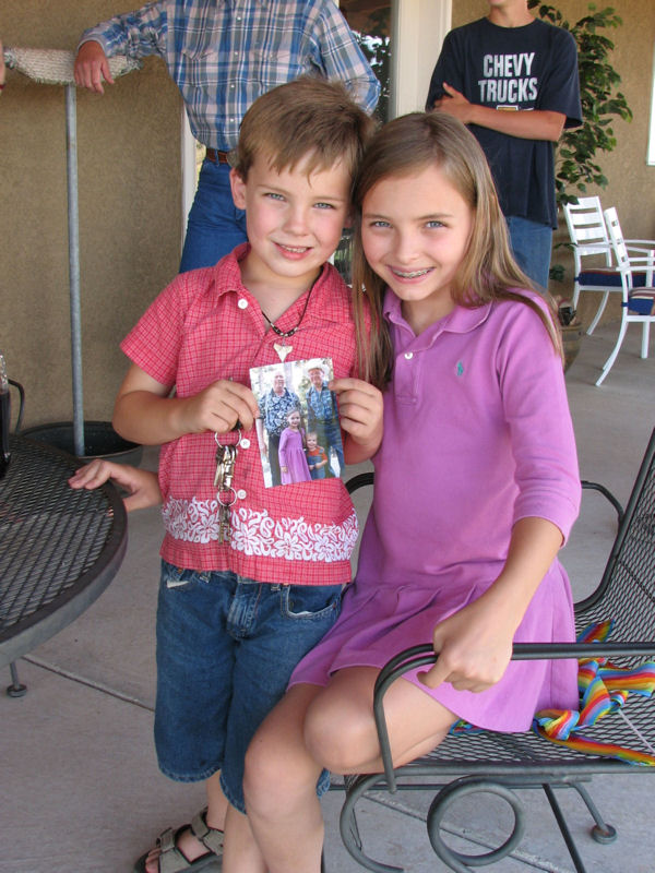 Steele and Taarna, Sophora's grandchildren, show off their photo of Uncle George