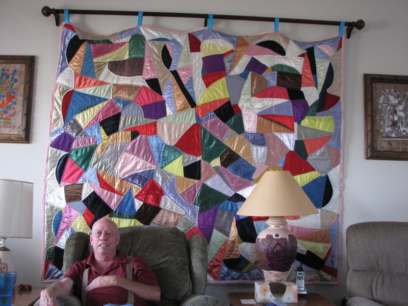 2007-07-29 A.J. sits in front of Mildred's 'crazy quilt' on display in his and Betty's home in Silver City