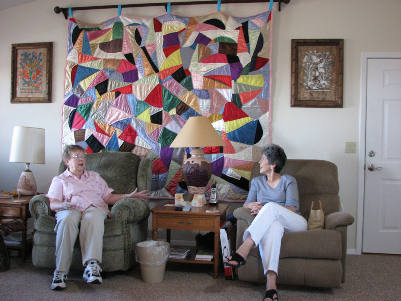 Betty and Eva admire the Crazy Quilt.