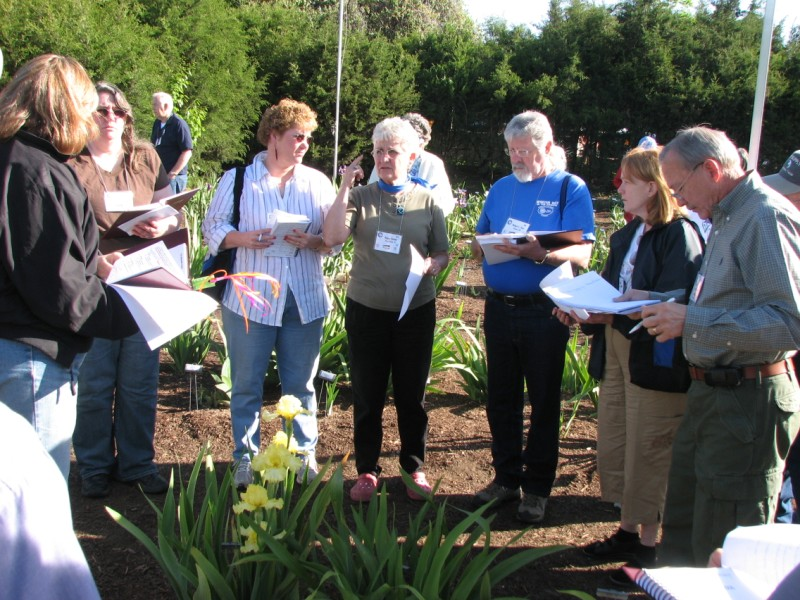 Bonnie Nichols (with back to camera) conducts garden judging training on Saturday at the Natural Gardener