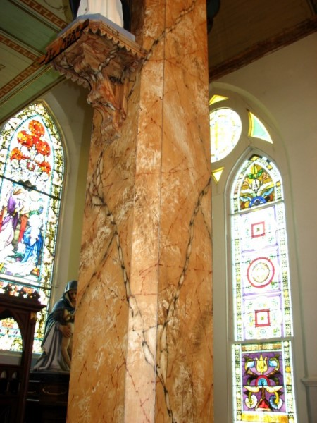 Wooden columns painted to resemble marble