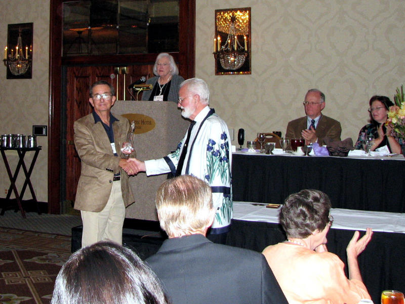 Barry Blyth is presented the Fred and Barbara Walther Cup for 'Decadence,' which he was awarded in 2006  (Photo by Larry Nunn)