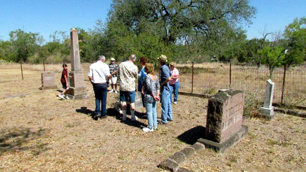 Descendants of Pastor Adolf Fuchs visit his grave site during the 2011 Fuchs/Fox Family Reunion.