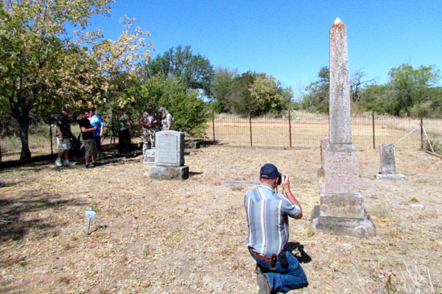Great-great-grandson Ron Fox takes a picture of the obelisk.